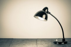 black desk lamp on wood table