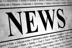 news topics, printed on a newspaper