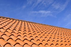 red roof tiles under a blue sky